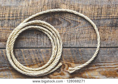 rope coiled on a wooden table close up