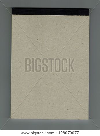 Notepad also known as block notes with grey cover