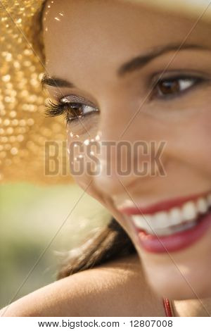Caucasian mid-adult female close-up wearing straw hat.