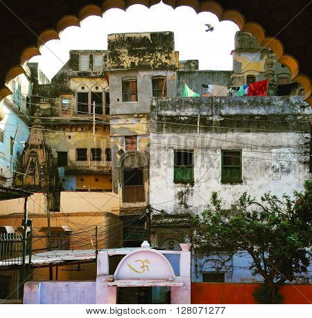 India, Varanasi, - March 9, 2015: Old indian houses in the yard, building development in old Indian city, street life in India
