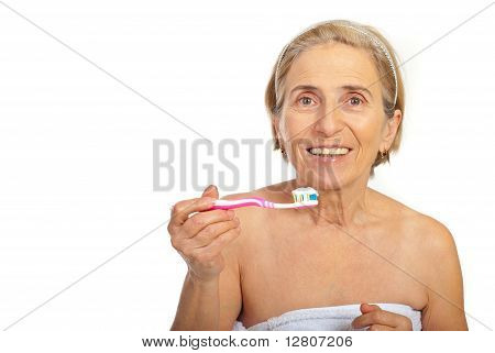 Smiling Senior Woman With Tooth Brush