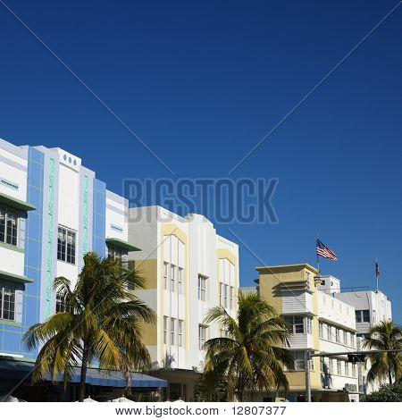 Palm trees and buildings in art deco district of Miami, Florida, USA.