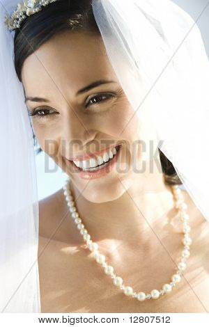 Portrait of Caucasian mid-adult bride smiling.