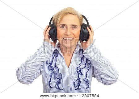 Happy Senior Woman Listening In Headphones