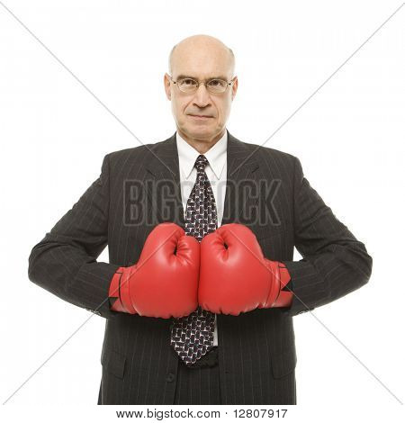 Caucasian middle-aged businessman wearing boxing gloves.