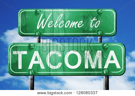 tacoma vintage green road sign with blue sky background