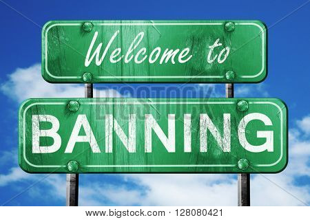 banning vintage green road sign with blue sky background