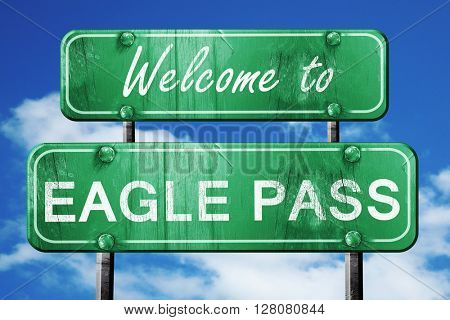 eagle pass vintage green road sign with blue sky background