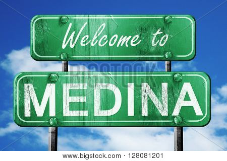 medina vintage green road sign with blue sky background