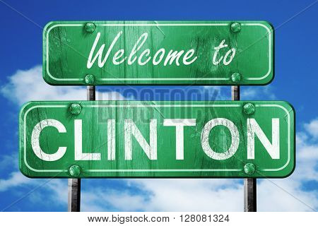 clinton vintage green road sign with blue sky background