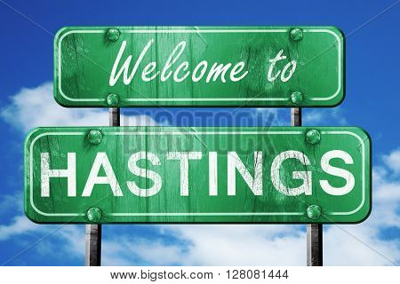 hastings vintage green road sign with blue sky background