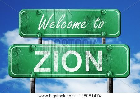 zion vintage green road sign with blue sky background