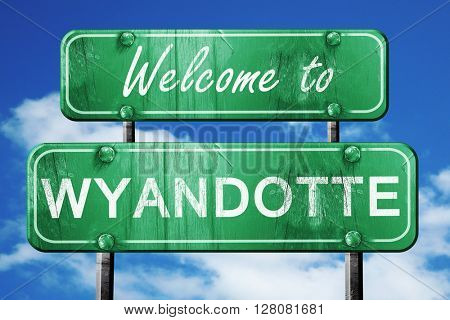 wyandotte vintage green road sign with blue sky background
