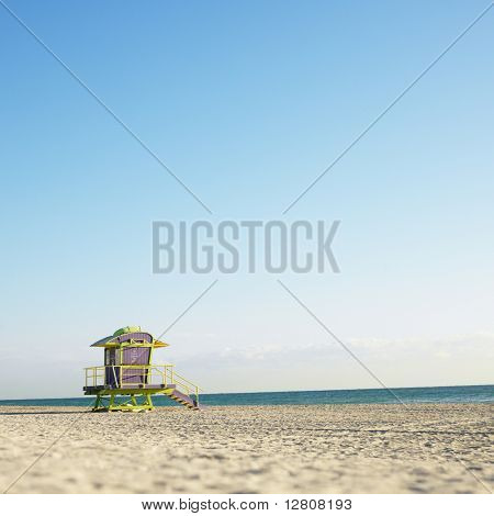 Art deco lifeguard tower on deserted beach in Miami, Florida, USA.