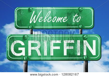 griffin vintage green road sign with blue sky background