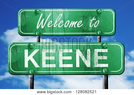 keene vintage green road sign with blue sky background
