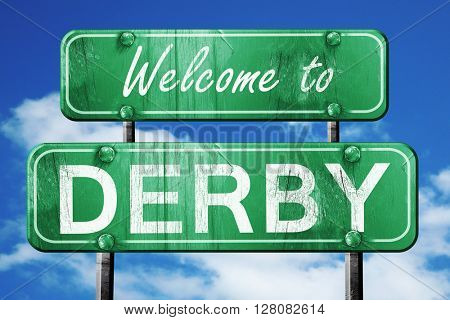 derby vintage green road sign with blue sky background