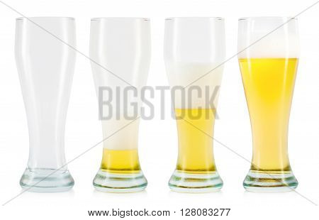 empty and full beer glasses on white