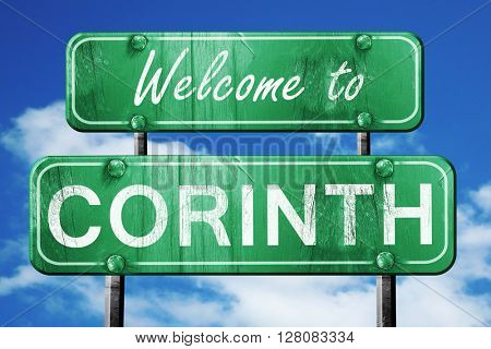 corinth vintage green road sign with blue sky background