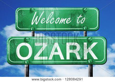 ozark vintage green road sign with blue sky background