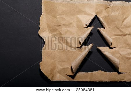 photo of aged torn paper christmas tree