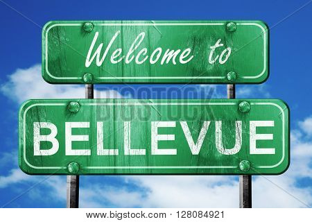 bellevue vintage green road sign with blue sky background
