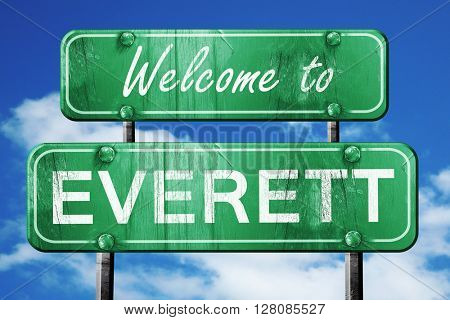 everett vintage green road sign with blue sky background