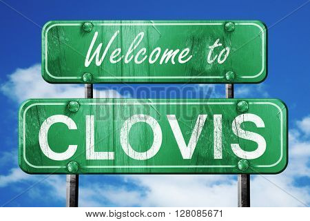 clovis vintage green road sign with blue sky background