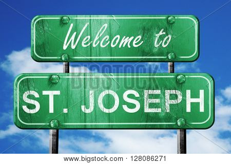 st. joseph vintage green road sign with blue sky background