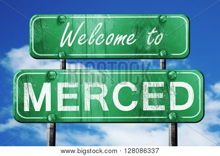 merced vintage green road sign with blue sky background