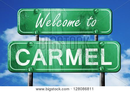 carmel vintage green road sign with blue sky background