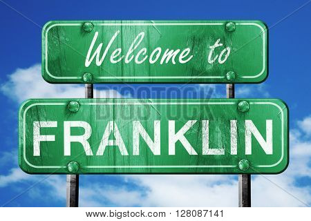 franklin vintage green road sign with blue sky background