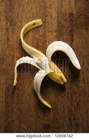 Close up still life of half eaten banana.