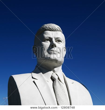 Bust of John F. Kennedy sculpture against blue sky in President's Park, Black Hills, South Dakota