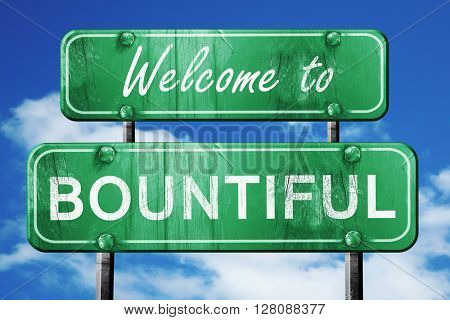 bountiful vintage green road sign with blue sky background