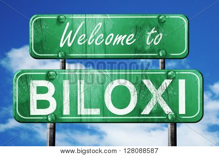 biloxi vintage green road sign with blue sky background