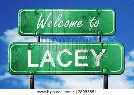 lacey vintage green road sign with blue sky background