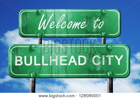 bullhead city vintage green road sign with blue sky background
