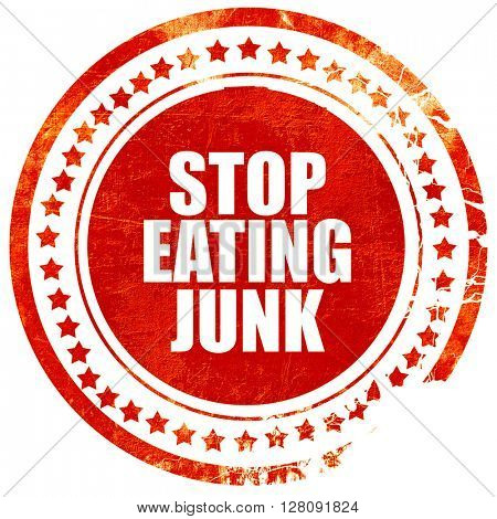 stop eating junk, grunge red rubber stamp with rough lines and e