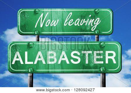 Leaving alabaster, green vintage road sign with rough lettering