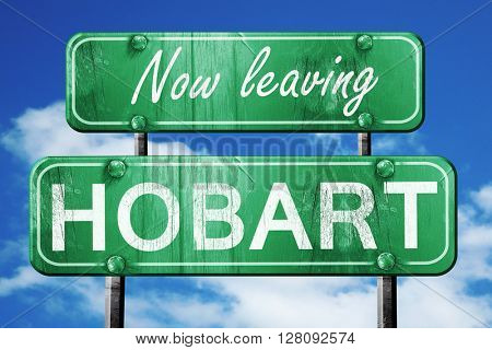 Leaving hobart, green vintage road sign with rough lettering