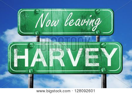 Leaving harvey, green vintage road sign with rough lettering