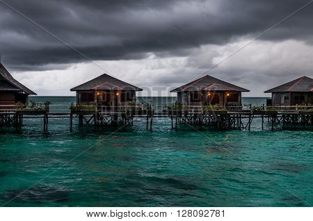 A shot of water villas in Sabah Malaysia during bad weather.