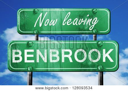 Leaving benbrook, green vintage road sign with rough lettering