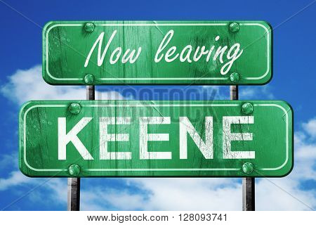 Leaving keene, green vintage road sign with rough lettering