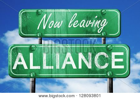 Leaving alliance, green vintage road sign with rough lettering
