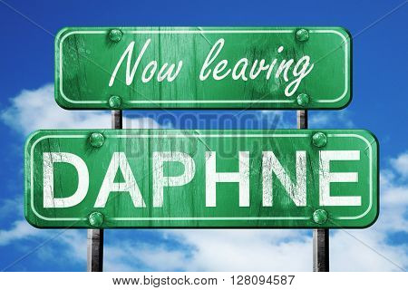 Leaving daphne, green vintage road sign with rough lettering