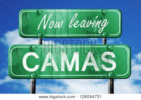 Leaving camas, green vintage road sign with rough lettering