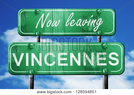 Leaving vincennes, green vintage road sign with rough lettering