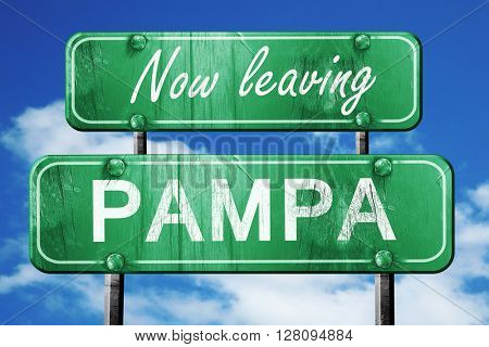 Leaving pampa, green vintage road sign with rough lettering